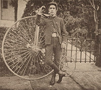 Dayton Miller with bicycle, about seventeen years old